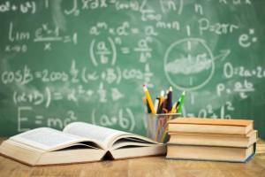 School books on desk, education concept