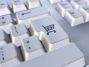A closeup of a keyboard with the return key symbol replaced with a shopping cart icon to indicate e-commerce.