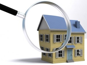 A magnifying glass examining a house. 3D render with HDRI lighting and raytraced textures.